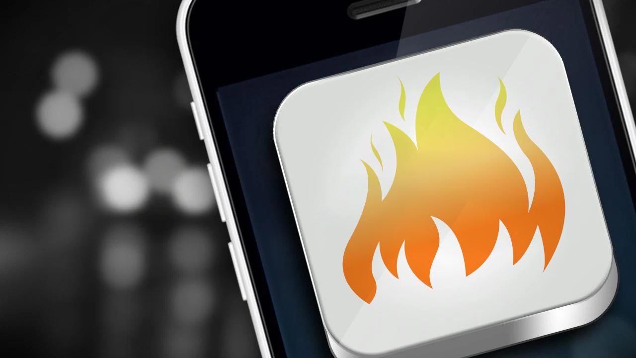 Tinder logo on mobile phone